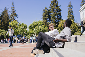 2 students talking on Sproul steps