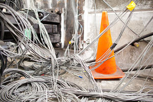 infrastructure wires with orange safety cone