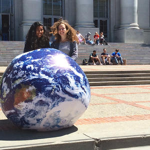 students with inflatable earth