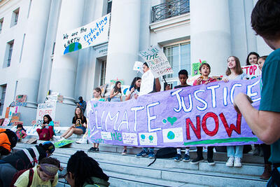 Climate Justice Now sign at Berkeley student-led climate strike