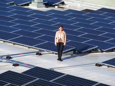 OS Director Kira Stoll atop RSF solar panels
